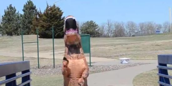 Theo the T-Rex at the StoryWalk®.
